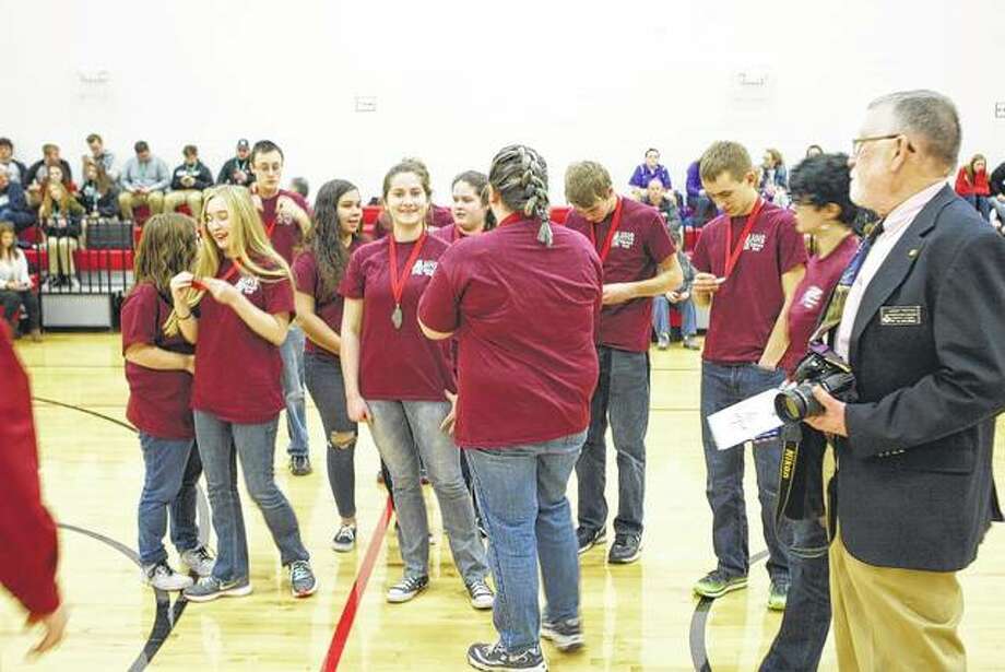 The Havana High School academic bowl team receives second-place medals Saturday at Virginia High School.