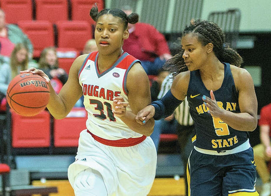 SIUE's Donshel Beck (left) moves the ball upcourt while Murray State's Jasmin Borders defends during Ohio Valley Conference women's basketball action Saturday night at Vadalabene Center in Edwardsville. Photo: SIUE Athletics