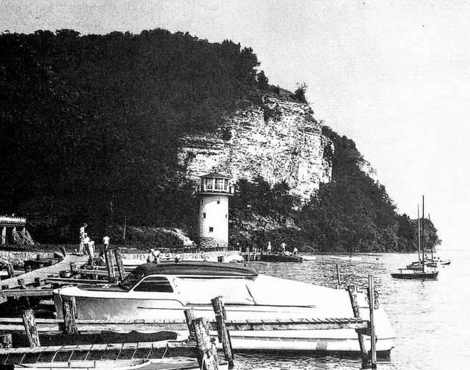 The railroad is gone. The steamers no longer stop at Chautauqua. But the peaceful summer resort continues to attract visitors of all ages. The lighthouse is still a landmark along the river. This scene shows the boat docks before the River Road was developed. The same limestone bluff is visible in an early photograph of an excursion boat docking at Chautauqua. Photo: File Photo