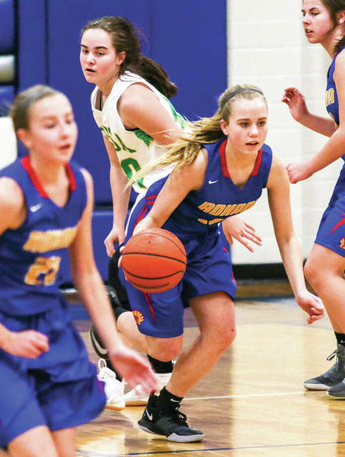 Roxana freshman Olivia Mouser (center) pushes the ball upcourt during a quarterfinal game against Southwestern at the Marquette Class 2A Regional in Alton. Photo: Nathan Woodside / For The Telegraph