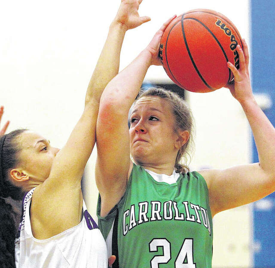 Carrollton's Hannah Krumwiede puts up a shot under pressure during Monday night's North Greene Sectional semifinal against Lebanon in White Hall. Photo: Dennis Mathes, Journal-Courier | For The Telegraph
