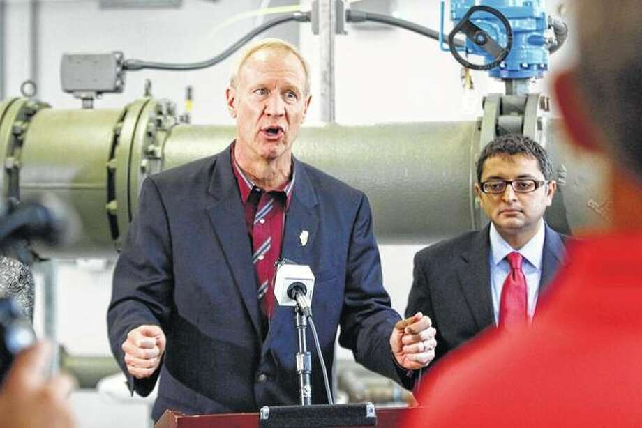 Gov. Bruce Rauner speaks July 27, 2016, at the water treatment facility of the Illinois Veterans Home in Quincy. A report obtained by The Associated Press shows engineers told Gov. Bruce Rauner's administration in 2016 that replacing problematic plumbing at a veterans' home beset by Legionnaires' disease would cost $8 million, much lower than the estimate provided by state officials. Photo: Jake Shane | Quincy Herald-Whig | AP