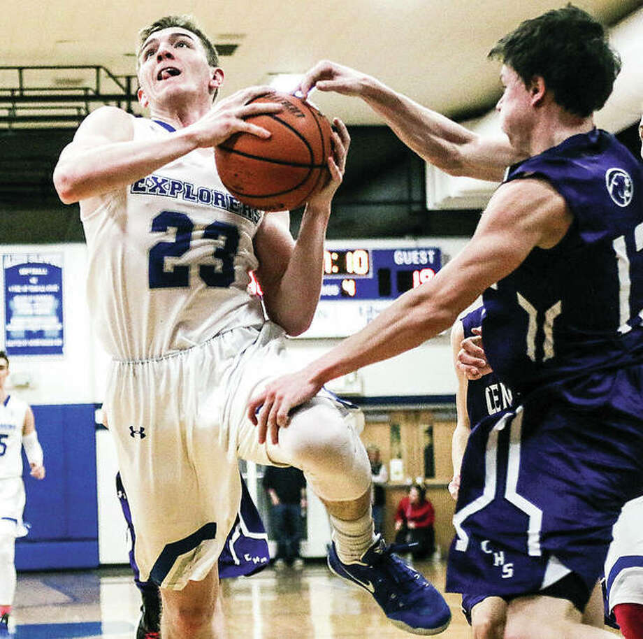 Marquette's Reagan Snider drives to the basket as Breese Central's Jackson Haag (11) gets a hand on the ball during Tuesday night's game at Marquette. Photo: Nathan Woodside | For The Telegraph