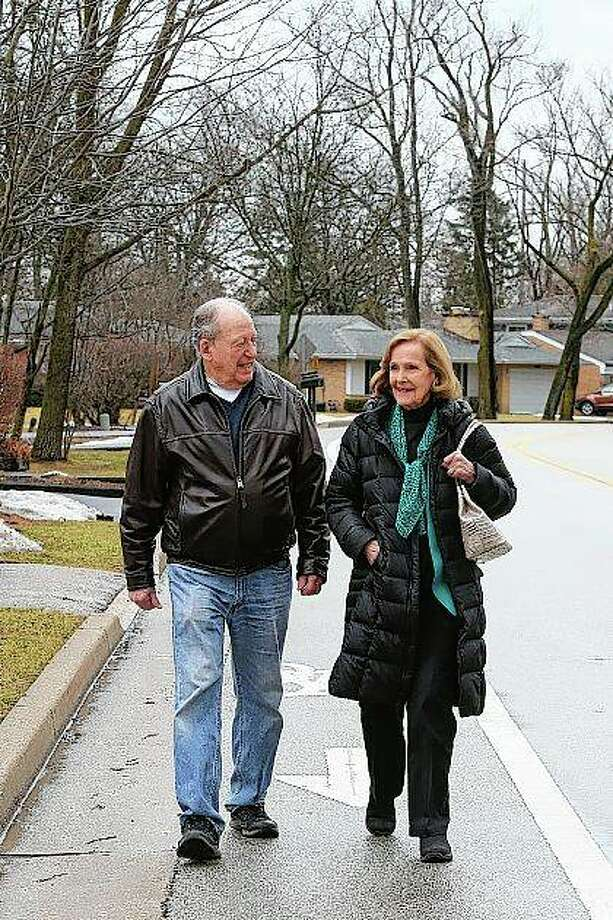 "Bill Gurolnick walks with his wife, Peggy Bartelstein, near their home in Northbrook. Gurolnick, who turns 87 in March, thinks his own stellar memory is bolstered by keeping busy. He bikes, and plays tennis and water volleyball. He stays social through regular lunches and meetings with a men's group he co-founded. ""Absolutely that's a critical factor about keeping your wits about you,"" exclaimed Gurolnick, fresh off his monthly gin game. Teresa Crawford 