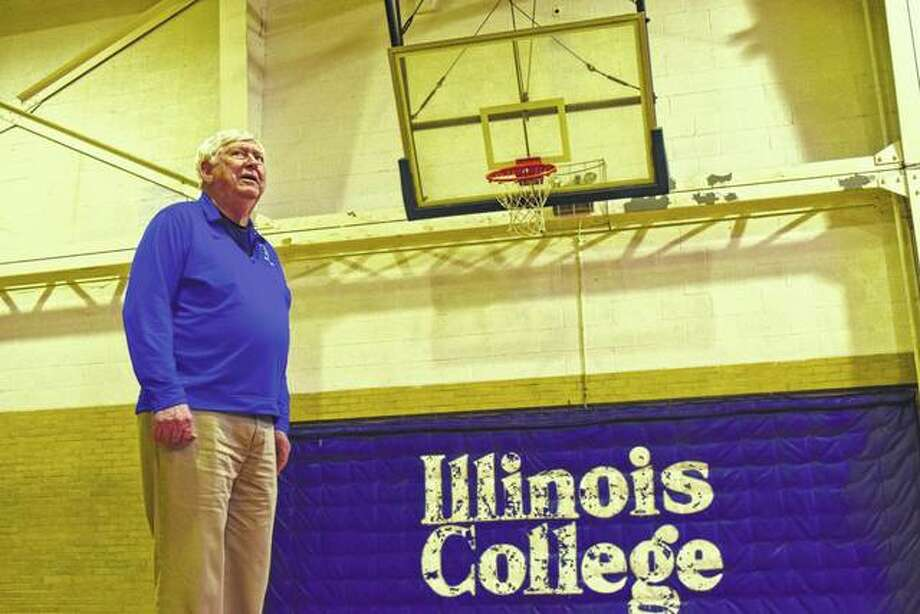Bill Merris, who coached the Illinois College men's basketball team from 1958 to 1996, looks over IC's Memorial Gymnasium, which will be demolished later this year.