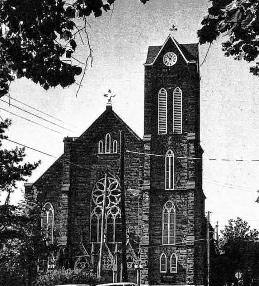 """St. Mary's Catholic Church was founded in 1859, in response to the needs of the fast-increasing population of German settlers in Alton. When the Cathedral was built on State Street, Bishop Jungker arranged for special services in German. The demand for a separate church grew, and St. Mary's, the Church of the Immaculate Conception was built in 1859. The first floor contained rooms for the pastor and schoolrooms, with the church on the second floor. The structure was destroyed by a tornado in 1860, leaving the congregation with the unpaid debt. An appeal was made to churches in eastern cities, and a new church was soon started. The present structure, of Bedford stone, was completed in 1895. Lucas Pfeiffenberger of Alton was the supervising architect. The church contains an outstanding pipe organ, and many an Altonian can recall Professor Max Hendelmeyer's moving rendition of """"The Bells of St. Mary's."""" Hendelmeyer was an organist and choir director during the 1940s and 1950s. Photo: File Photo"""