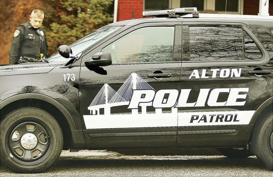 "The Alton Police Department has introduced two designs for their new police cars. The first is similar to the old design but no longer will have white doors, no yellow on the bridge and no blue stripe, but are now made of a reflective white material. The department is also trying out a black-logo-on-black-car design they call ""low profile."" The black logo is also reflective and will light up brightly when hit by car headlights at night, but is harder to see during the day. Photo: John Badman 