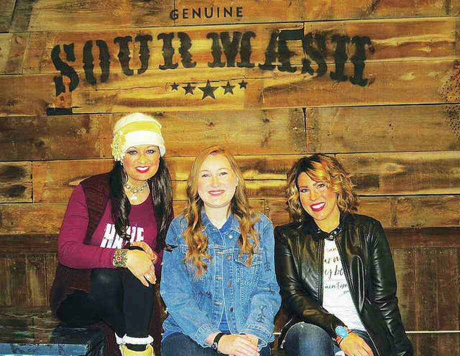 Sour Mash Boutique owner Kenneathia Williams, of Edwardsville, had the opportunity to gift one of her favorite music artists, Drake White, with a cuff at a recent concert in Springfield, Illinois, and has designed custom cuffs for White and his band. Her retail destination boutique opened in Downtown Edwardsville on Valentine's Day. Sour Mash Boutique owner Kenneathia Williams with Emily Whitaker and Cindy McCalla at the store, located in Downtown Edwardsville. Photo: Carol Arnett|For The Telegraph