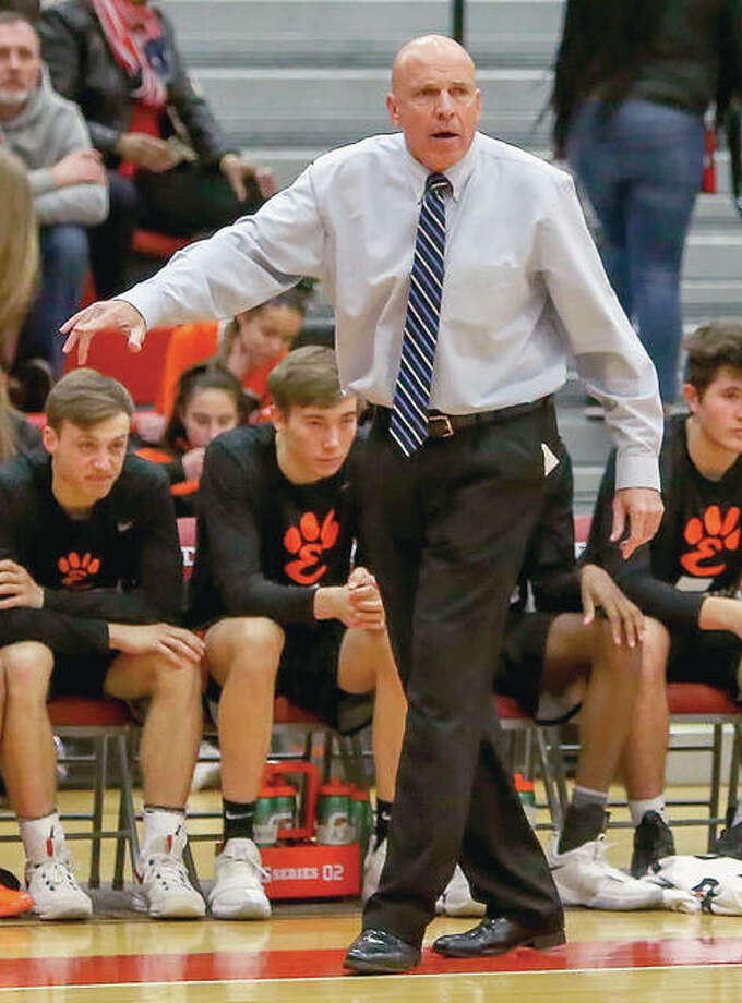 Edwardsville coach Mike Waldo gives his team instructions during Friday's game at AHS. Photo: Scott Kane | For The Telegraph