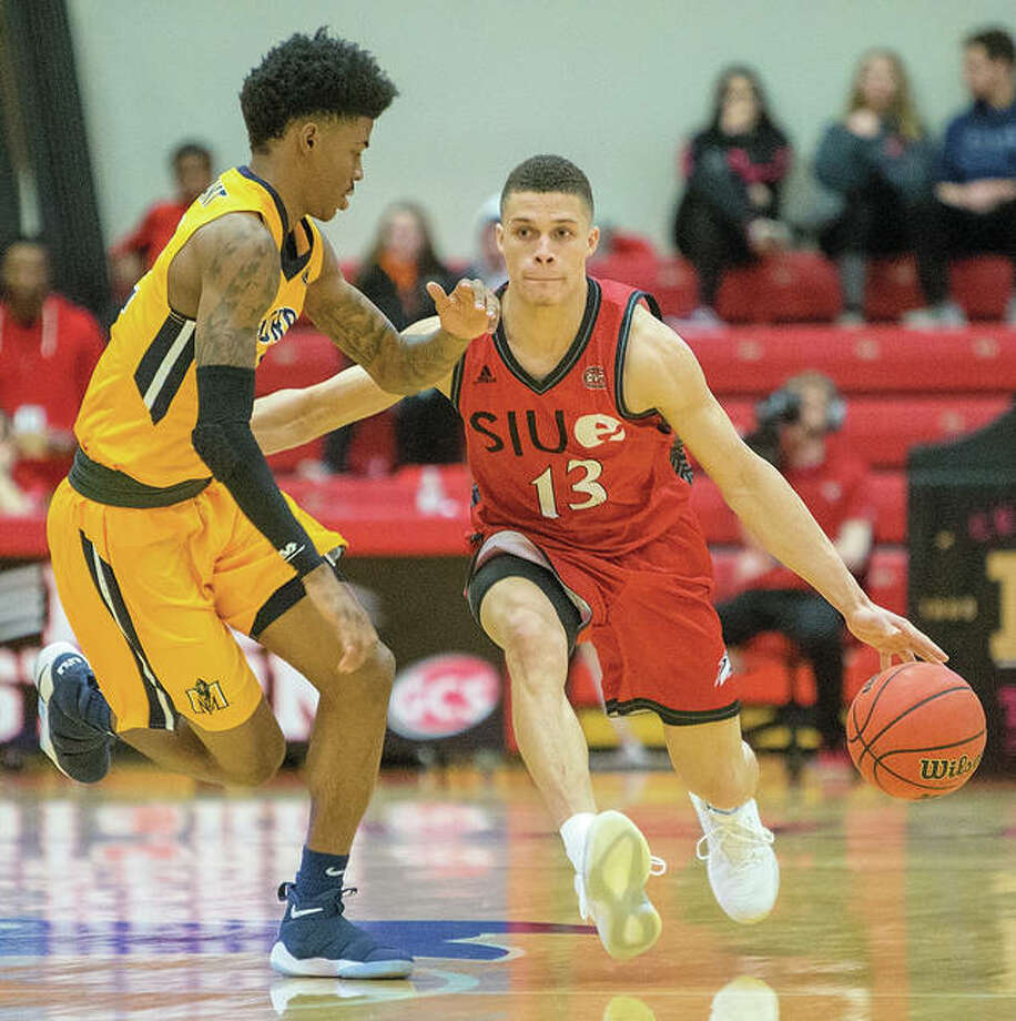 SIUE's Christian Ellis (right), shown handling the ball against defensive pressure from Murray State on Feb. 10 at Vadalabene Center in Edwardsville, scored 19 points to lead five Cougars in double figures Saturday in a OVC loss to Southeast Missouri in Cape Girardeau, Mo. Photo: SIUE Athletics