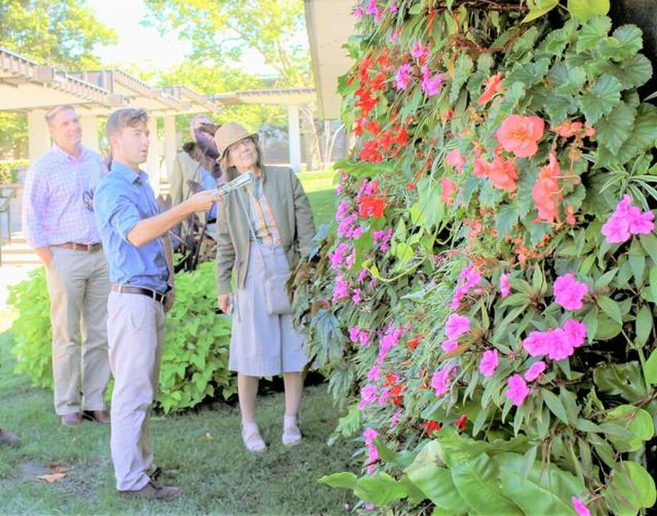 "Ethan Braasch, Lewis and Clark Community College's (L&C) horticulture manager, talks about L&C's summer signature garden, ""Gardens Through the Looking Glass,"" during a past event visit by representatives from Ball Horticultural and Hortica. The group visited the Monticello Sculpture Gardens at L&C's campus in Godfrey and toured the NGRREC Field Station in East Alton as well. Photo: For The Telegraph"