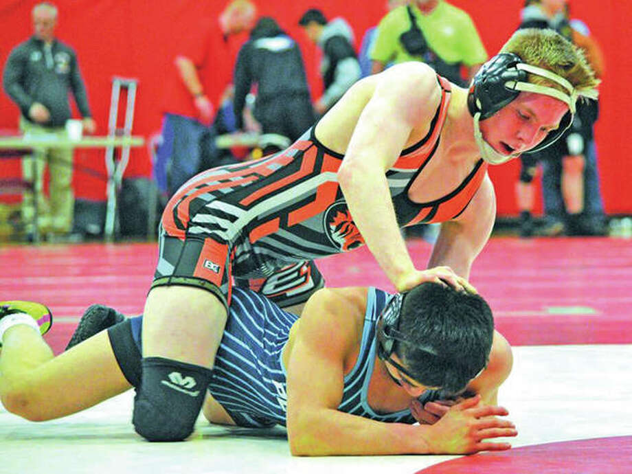 Edwardsville junior Noah Surtin (top) is in control of Plainfield South's Enzo Silva during their 113-pound title match at the Alton Class 3A Sectional on Feb. 10 in Godfrey. Surtin won the sectional and on Saturday night won a state championship in Champaign. Photo: Scott Marion / For The Telegraph