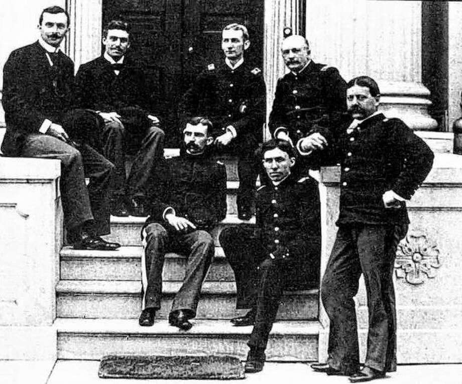 """Pictured is an early portrait of the faculty of Western Military Academy at the front of the Bostwick home that served as the first school. Colonel Albert M. Jackson began teaching mathematics at Wyman Institute in 1887. Jackson was a graduate of Princeton and was to play a major role in the development of the school. Dr. Wyman died suddenly in 1888. Jackson, the youngest man on the staff, was selected as principal. At the inception of his school, Dr. Wyman adopted as his motto """"Mens Sans in Corpore Sano, A Sound Mind is a Sound Body."""" Photo: File Photo"""