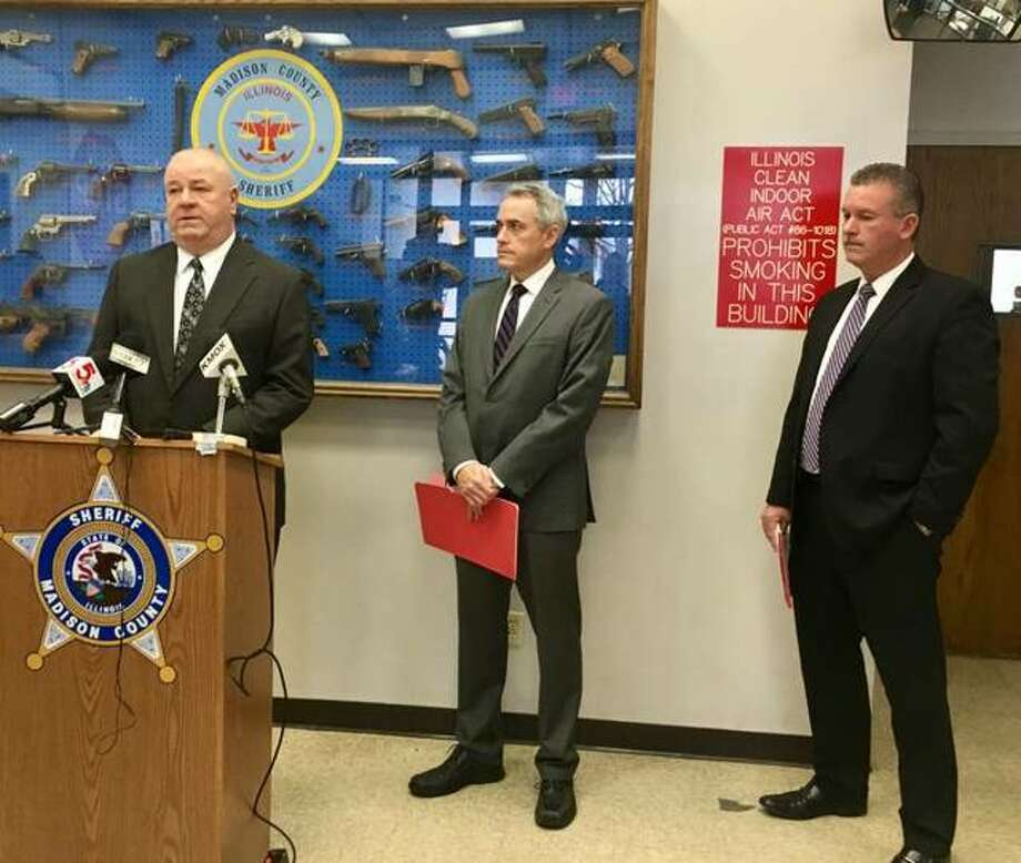 Madison County Sheriff John Lakin speaks at a news conference Tuesday as State's Attorney Tom Gibbons, middle, and Maj. Jeff Connor listen. The press conference was regarding charges filed in a shooting death in Glen Carbon earlier this month.