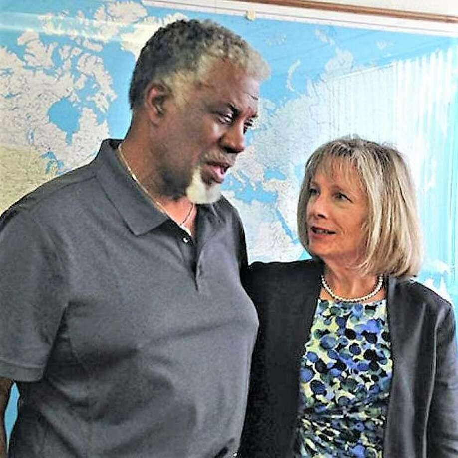Lincoln School Alumni Foundation President Herman Shaw talks with Edwardsville District 7 Superintendent of Schools Dr. Lynda Andre at a past meeting. Photo: Bill Tucker | For The Telegraph