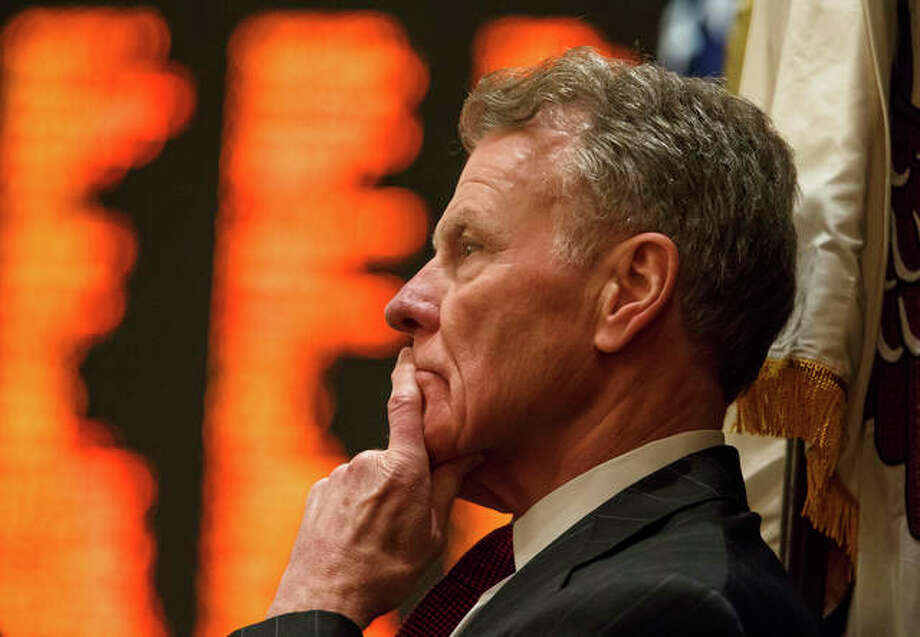 In this Aug. 28, 2017 file photo, Illinois Speaker of the House Michael Madigan, D-Chicago, looks out over the floor the Illinois House as they get set to vote on the education funding bill for a second time during a special session at the Illinois State Capitol in Springfield, Ill. A growing number of Illinois Democrats are calling for an independent investigation of misconduct within Madigan's political and state operations. Madigan, who's also chairman of the Democratic Party of Illinois, has dismissed two campaign workers in recent days following complaints of sexual harassment and other inappropriate behavior. Photo: Justin L. Fowler/The State Journal-Register Via AP