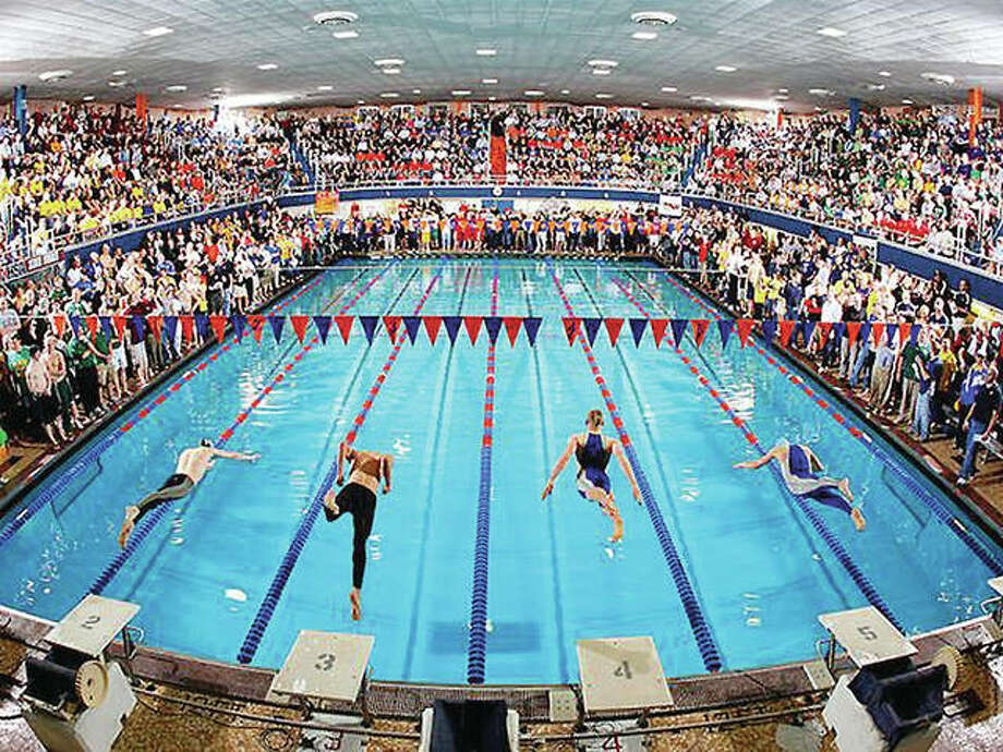 The Evanston Township High School pool will be packed for the IHSA Boys State Swim Meet Friday and Saturday. Above, swimmers hit the water at an earlier state meet. Photo: Wildkit Aquatics Photo