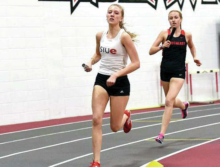 SIUE's Aly Goff, front, placed first at the Marshall Invite, while setting a personal record in the mile. Goff's time is second all-time for SIUE and sixth fastest in the Ohio Valley Conference this season. She and her teammates travel to Charleston Friday and Saturday to compete in the OVC Indoor Championships. Photo: SIUE Athletics