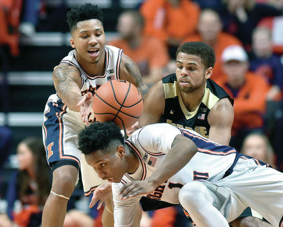 Illinois guard Te'Jon Lucas (3) and guard Trent Frazier go for a loose ball against Purdue guard P.J. Thompson (11) Thursday night in Champaign.
