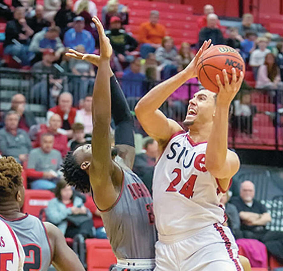 SIUE's Jalen Henry, right, goes up for a shot Thursday night against Austin Peay at the Vadalbene Center. Harris scored 26 points and became the 16th player in SIUE men's basketball history to reach 1,000 points, but the Cougars lost 86-82. Photo: SIUE Athletics