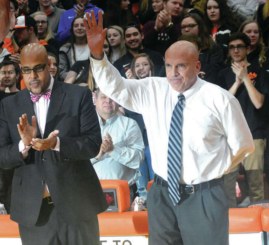 Edwardsville coach Mike Waldo, right, acknowledges the crowd during a pregame ceremony before Friday's game against Belleville East. It was Waldo's final home game as coach. EHS athletic director Alex Fox at left. Photo: Matt Kamp | For The Telegraph