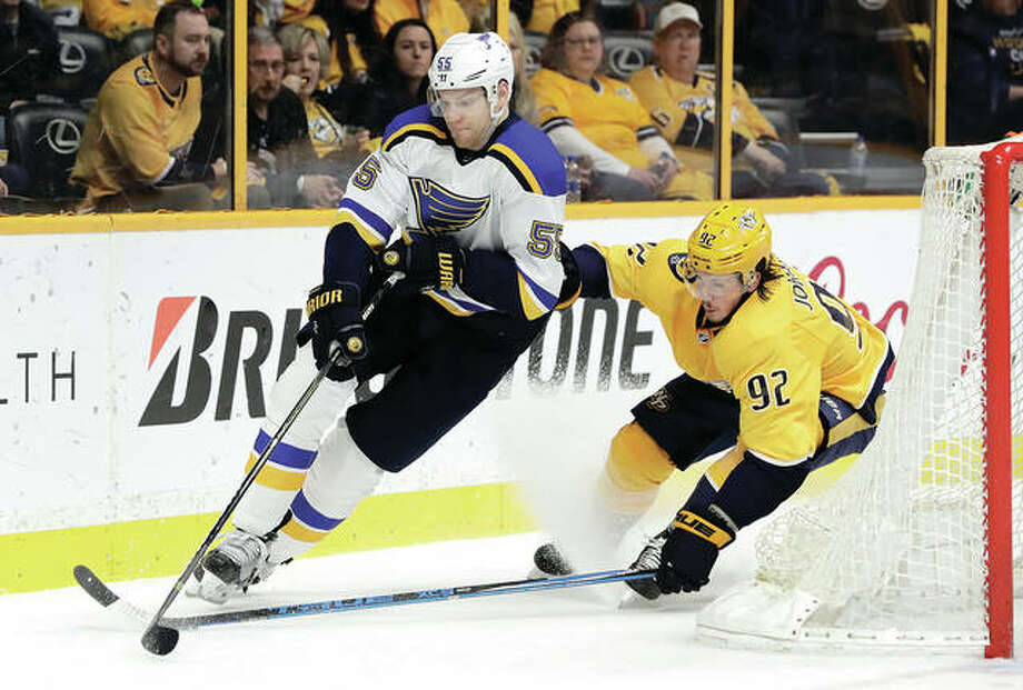 Blues defenseman Colton Parayko (left) carries the puck ahead of the Predators' Ryan Johansen in the second period Sunday in Nashville, Tenn. Photo: Associated Press