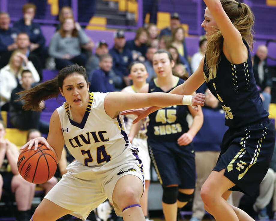 Civic Memorial's Kaylee Eaton (left) drives the lane against Teutopolis' Jolene Bueker during a victory that pushed the Eagles' record to 17-1 on Jan. 8 in Bethalto. Eaton finished her CM career with more than 1,200 and a 28-3 record as a senior. T-Town went on to finish third in the Class 2A state tourney. Photo: Billy Hurst / For The Telegraph