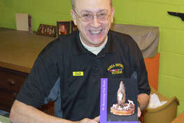 """Dennis Hunt with his book, """"Becoming One Flock: My Goal as Just One Christian."""""""