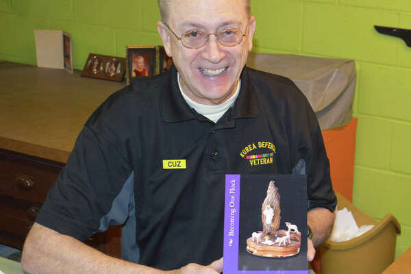 "Dennis Hunt with his book, ""Becoming One Flock: My Goal as Just One Christian."""