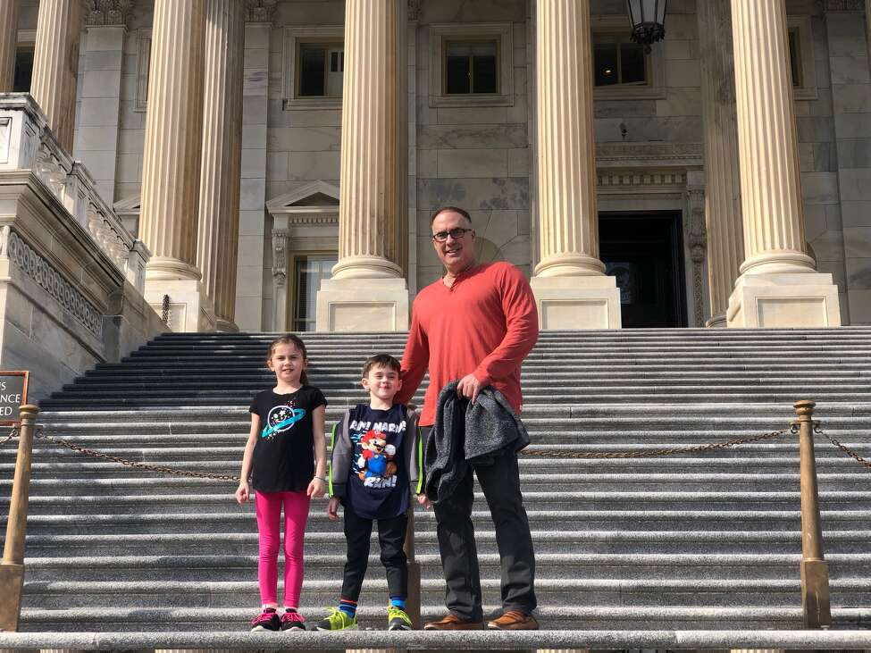 John Sweeney, of Clifton Park, on the steps of the U.S. Capitol with his kids, Julia, 7, and Colin, 5, during a school break road trip to the nation's capital last week.