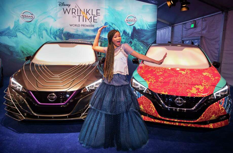 """IMAGE DISTRIBUTED FOR NISSAN NORTH AMERICA - Storm Reid strikes a pose with the custom Nissan LEAF at the """"A Wrinkle in Time"""" world premiere at the El Capitan Theatre on Monday, Feb. 26, 2018 in Los Angeles. (Photo by Colin Young-Wolff/Invision for Nissan North America/AP Images) Photo: Colin Young-Wolff, Associated Press / 2018 Invision"""