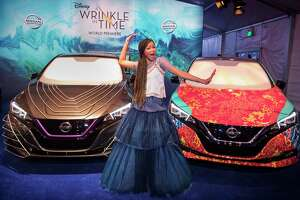 "IMAGE DISTRIBUTED FOR NISSAN NORTH AMERICA - Storm Reid strikes a pose with the custom Nissan LEAF at the ""A Wrinkle in Time"" world premiere at the El Capitan Theatre on Monday, Feb. 26, 2018 in Los Angeles. (Photo by Colin Young-Wolff/Invision for Nissan North America/AP Images)"