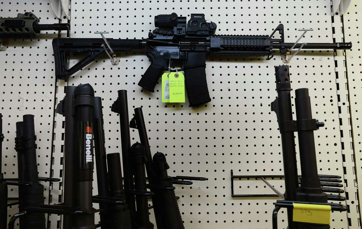 This 2012 photo shows an AR-15 assault rifle on display at a gun shop in Wendell, N.C.