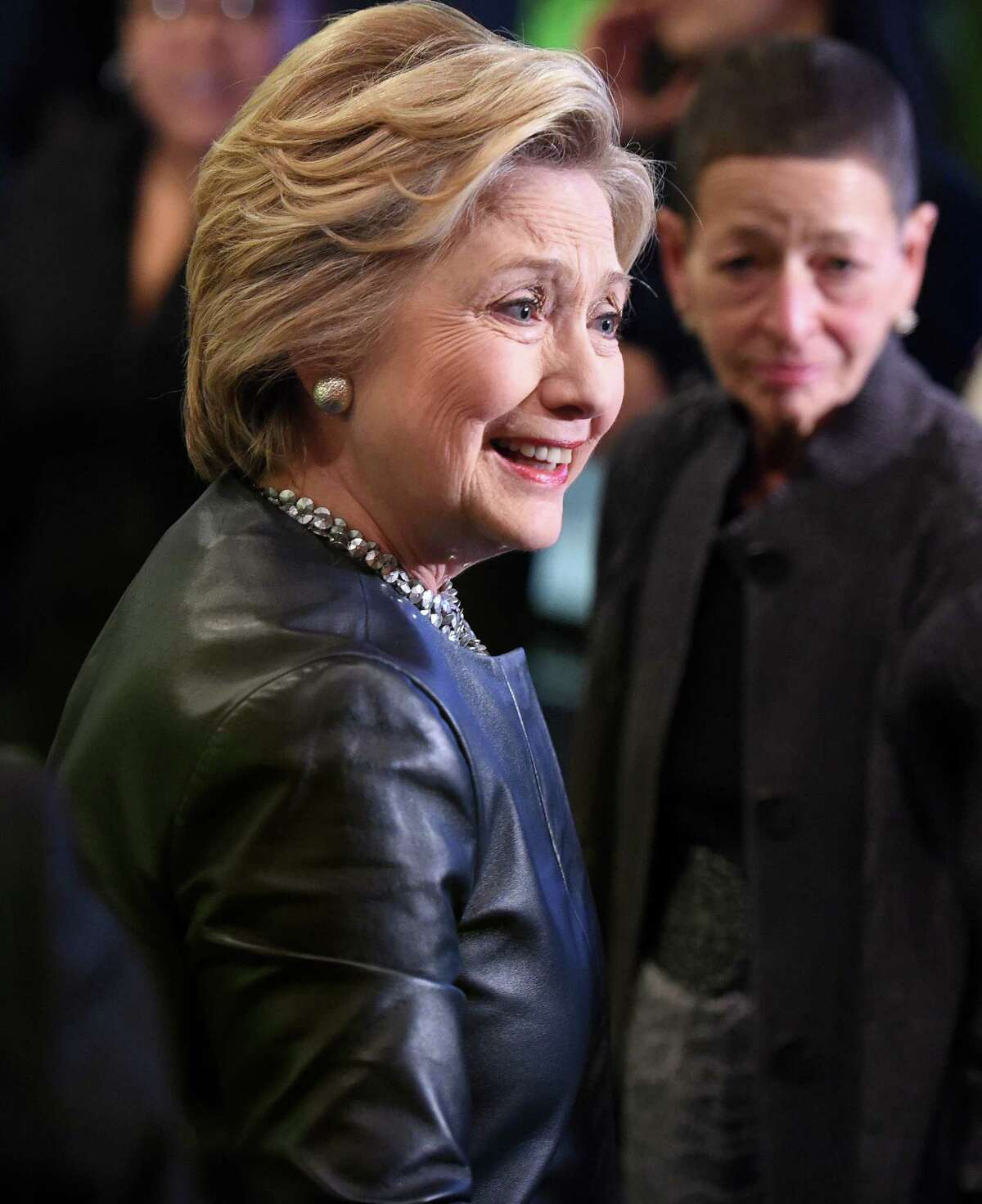 (Arnold Gold-New Haven Register) Democratic presidential candidate Hillary Clinton (center) arrives at a campaign stop at Orangeside on Temple in New Haven, Connecticut, on April 23, 2016.
