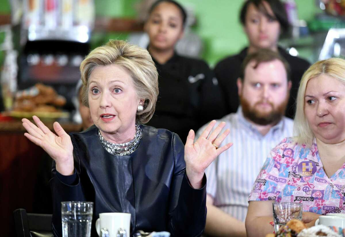 (Arnold Gold-New Haven Register) Democratic presidential candidate Hillary Clinton (left) speaks at a campaign stop at Orangeside on Temple in New Haven, Connecticut, on April 23, 2016. At right is Maribel Rodriguez a Certified Nursing Assistant from Waterbury.