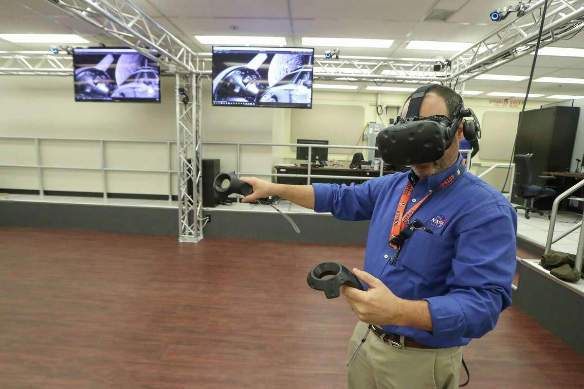 Eddie Paddock uses virtual reality equipment in the 'pit' at NASA Monday, Feb. 26, 2018, in Houston.