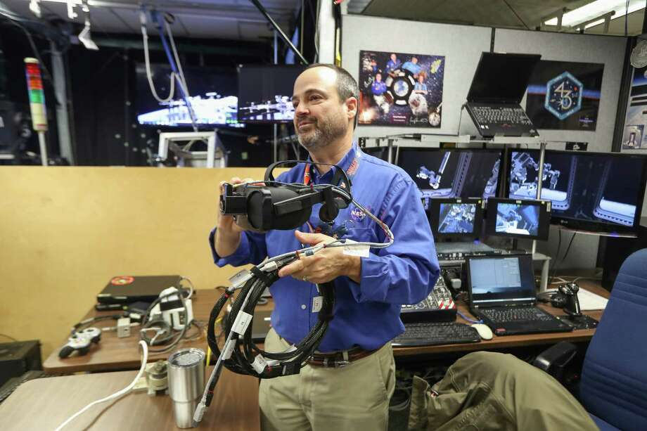 Eddie Paddock shows off virtual reality headset at NASA Monday, Feb. 26, 2018, in Houston. A similar device is scheduled to be sent to the International Space Station in April to help astronauts there with training. Photo: Steve Gonzales, Houston Chronicle / © 2018 Houston Chronicle