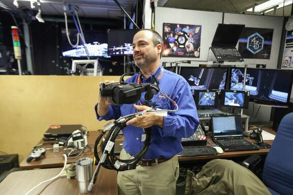 Eddie Paddock talks about the virtual reality at NASA Monday, Feb. 26, 2018, in Houston.