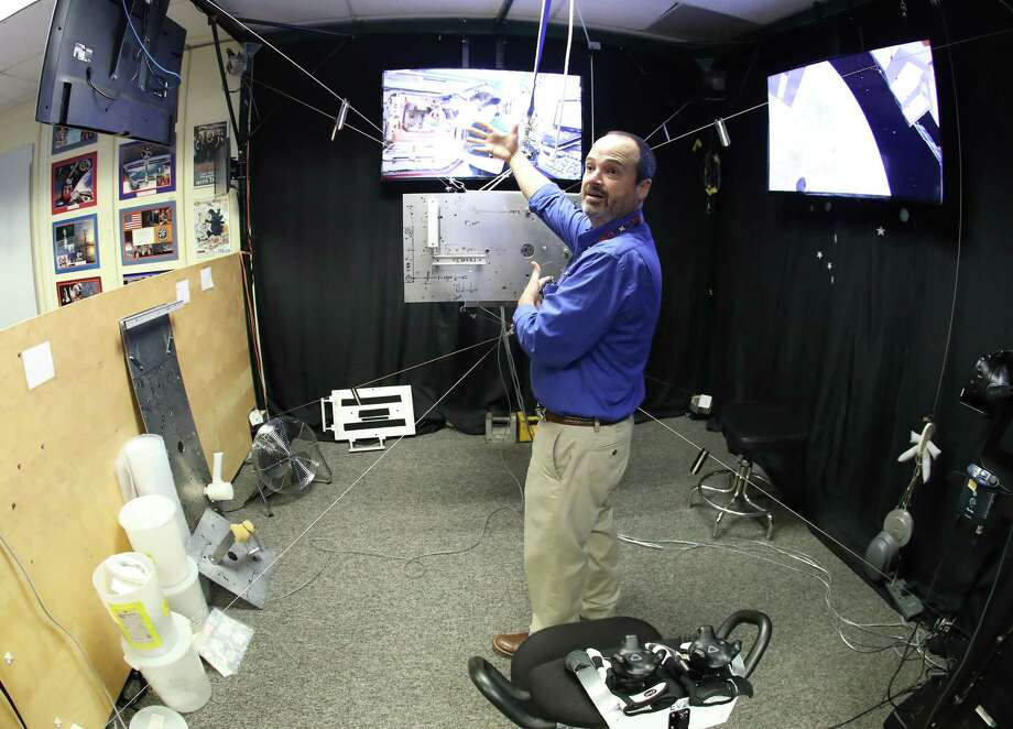 Eddie Paddock demonstrates Charlotte, which astronauts use as part of virtual reality at NASA Monday, Feb. 26, 2018, in Houston. Astronauts wear VR headsets and software turns Charlotte, a metal frame in the shape of a cube, into a piece of equipment to be installed on the outside the International Space Station.  Photo: Steve Gonzales, Houston Chronicle / © 2018 Houston Chronicle
