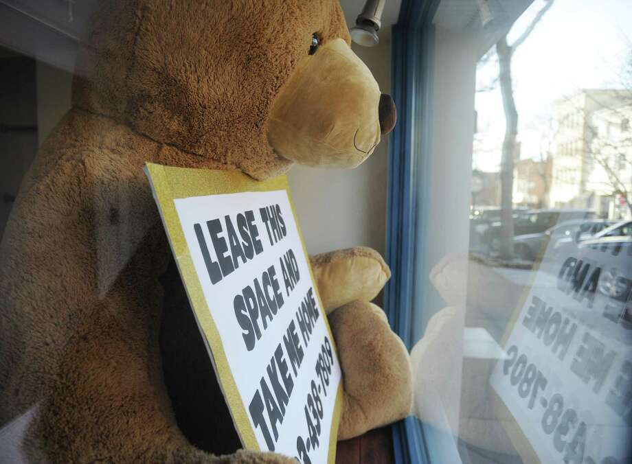 "A stuffed bear holding a sign saying ""Lease this space and take me home"" is shown in the window of a vacant property along Greenwich Avenue in Greenwich, Conn. Tuesday, Feb. 13, 2018. Photo: Tyler Sizemore / Hearst Connecticut Media / Greenwich Time"