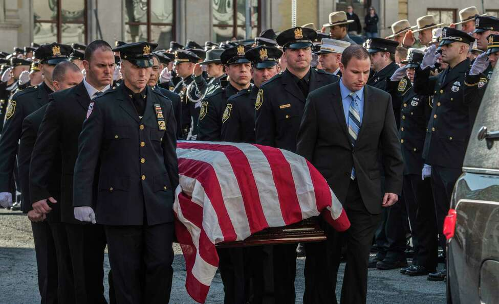 Fallen Albany Police Detective Kevin Meehan's remains are carried from St. Mary's Church for his internment at the cemetery Tuesday Feb. 27, 2018 in Albany, N.Y. (Skip Dickstein/Times Union)