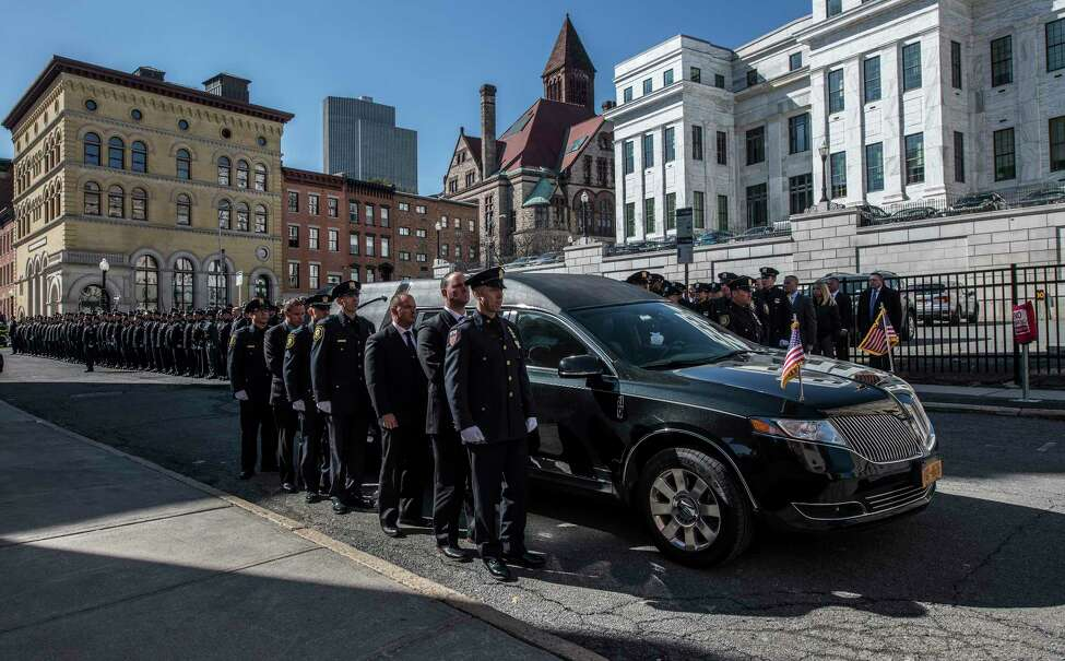 Fallen Albany Police Detective Kevin Meehan's remains are put in the hearse at St. Mary's Church for his internment at the cemetery Tuesday Feb. 27, 2018 in Albany, N.Y. (Skip Dickstein/Times Union)