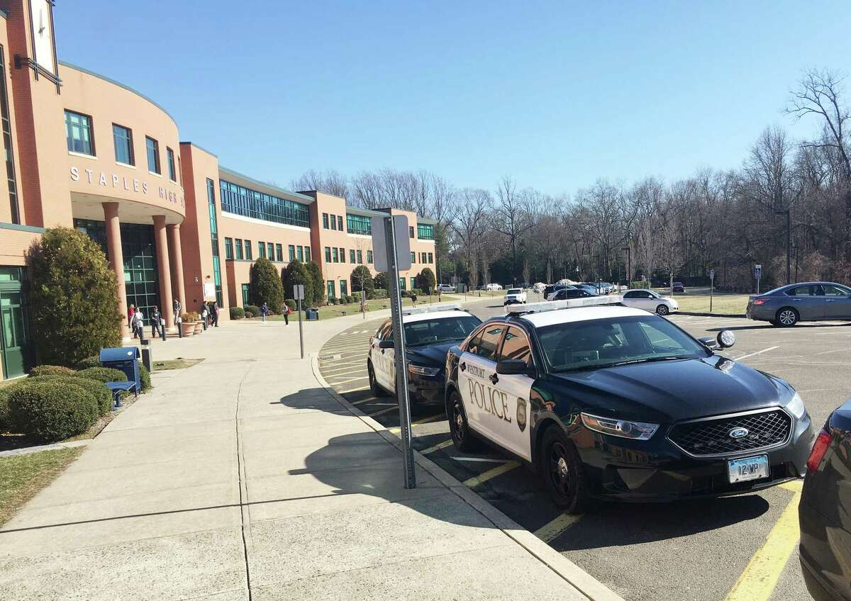 Westport Police cars outside of Staples High School on Feb. 27. The school dismissed early ?