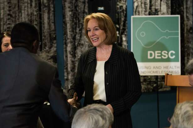 Mayor Jenny Durkan greets the crowd before the opening ceremony of DESC's new supportive housing project, The Estelle, on Rainier Ave S, on Tuesday, Feb. 27, 2018.