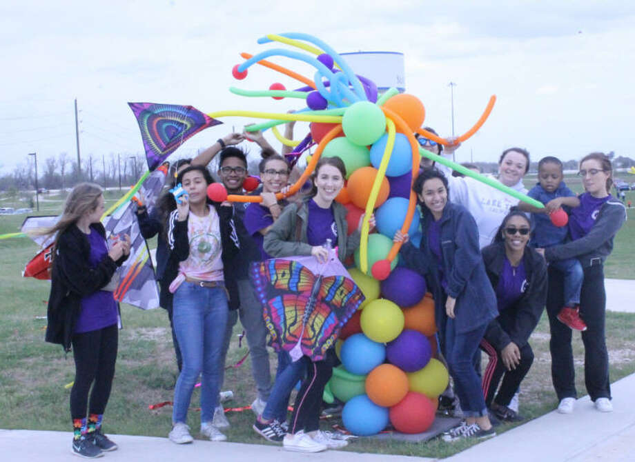Hope For Three Teen Huddle and siblings of children on the autism spectrum enjoy festivities at the annual Sugar Land Cultural Kite Festival at Brazos River Park. Photo: Hope For Three