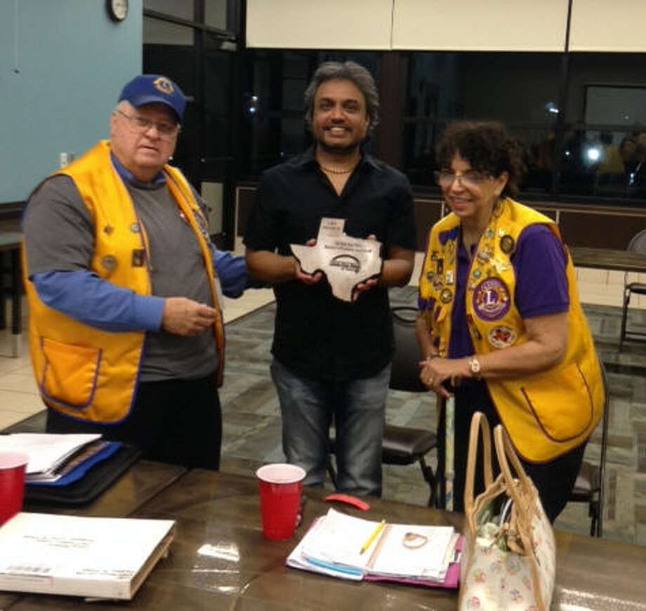 The Sugar Land Lions Club and Russo's Italian Restaurant, 403 Texas 6 S., joined forces and took part in White Cane Day drive for the Texas Eye Bank. All the money raised went directly to the eye bank where many will benefit in their eye care.To thank Mike Patel, the owner of Russo's, for his support of the drive, the club presented him with a plaque for a life membership in the eye bank. From left areLion President Ray Lehrmann, Patel and Lion Angela Rankin. Photo: Sugar Land Lions Club