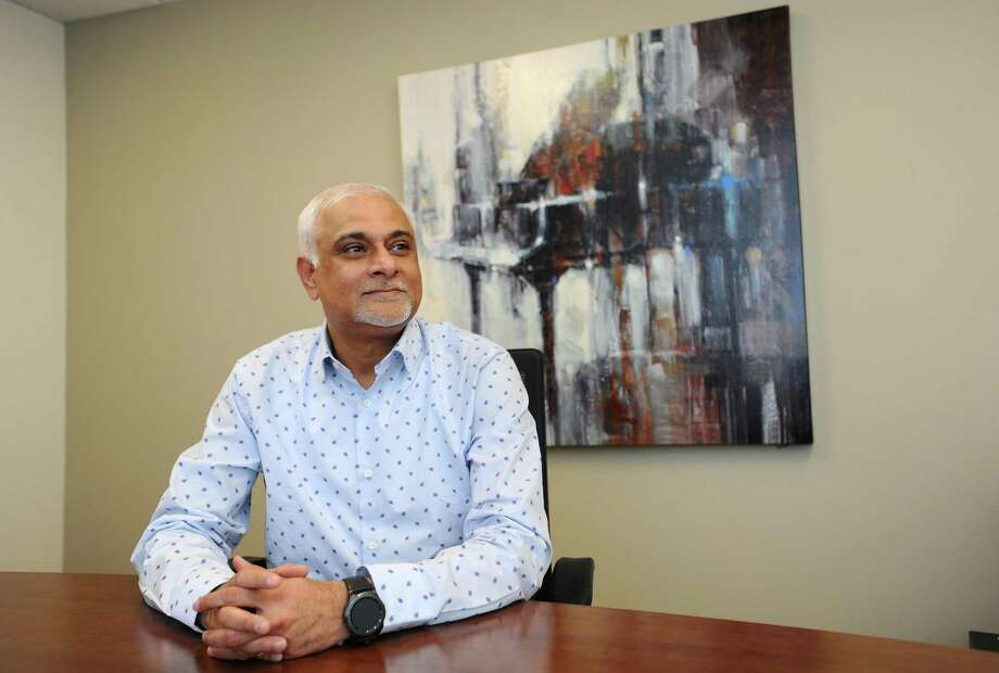 Sanjoy Chatterjee, CEO of financial-technology firm Investment Metrics, poses for a photo inside the company's headquarters in the Parklands Office Park in Darien, Conn., on Tuesday, Feb. 20, 2018. Photo: Michael Cummo / Hearst Connecticut Media / Stamford Advocate