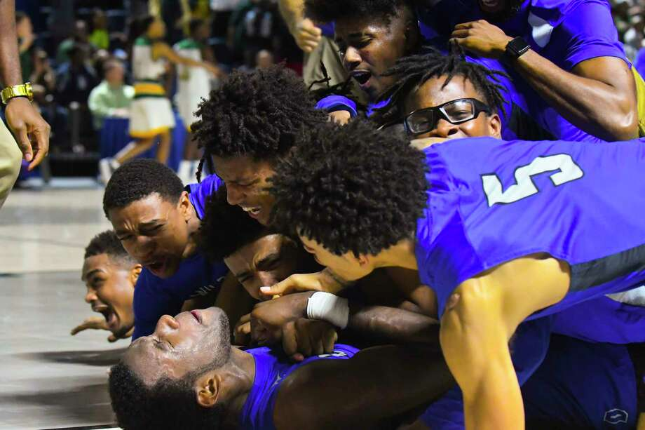 Dekaney (1) Malcom Epps is celebrated by his player after making the game winning 3 points basket with 2 seconds left in the game, in a highly contested game against Klein Forest Photo: Tony Gaines/ HCN, HCN / Houston Chronicle