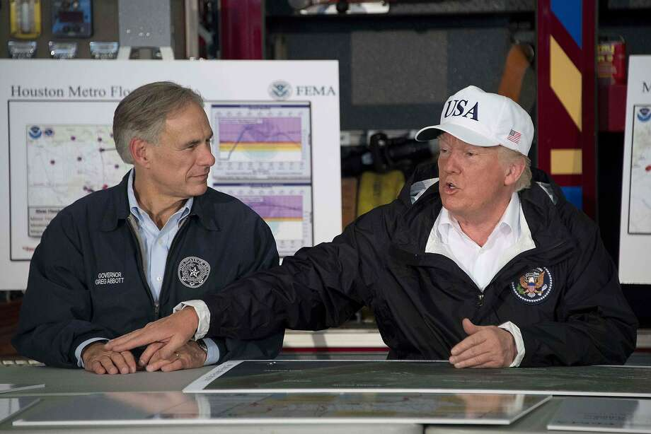 U.S. President Donald Trump (right) sits with Texas Governor Greg Abbott during a briefing on Hurricane Harvey in Corpus Christi, Texas on August 29, 2017. Some Texas Republicans are concerned about Trump's effect on their electoral races.  Photo: JIM WATSON, AFP/Getty Images