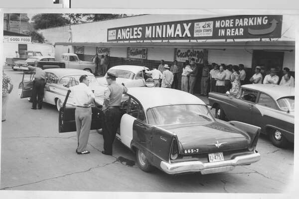 April 18, 1958Aftermath of of robbery outside Angles Minimax Store at Wayside and Navigation. Two men slugged grocery store manager Leonard Heathcook and escaped with $20,000 cash.